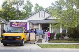 moving customers in front of home with their movers in driveway