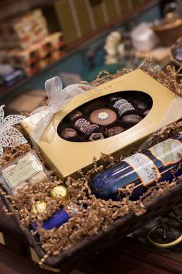 close up of chocolate and wine gift basked