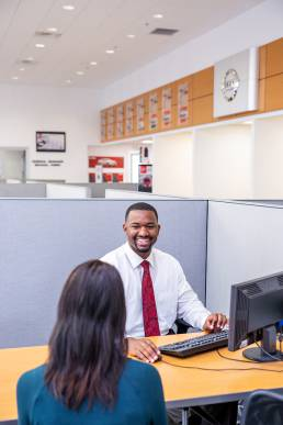 care salesman with customer in office