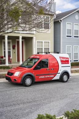 AC repair truck in front of house