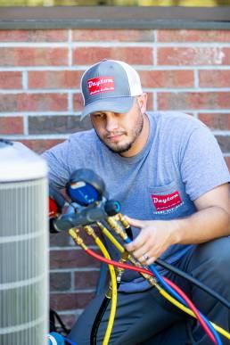 AC repair man at work